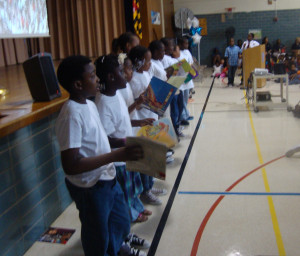 students performing with books