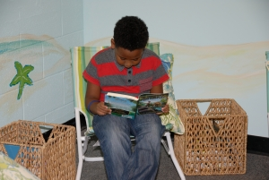boy in chair reading