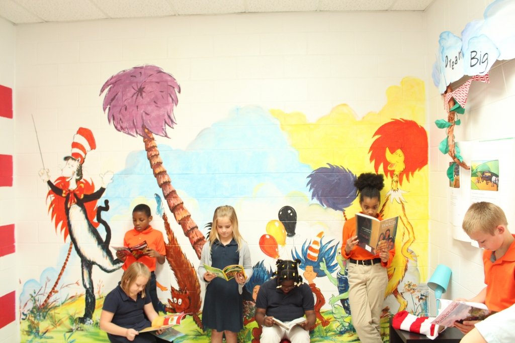 students-reading-with-mural